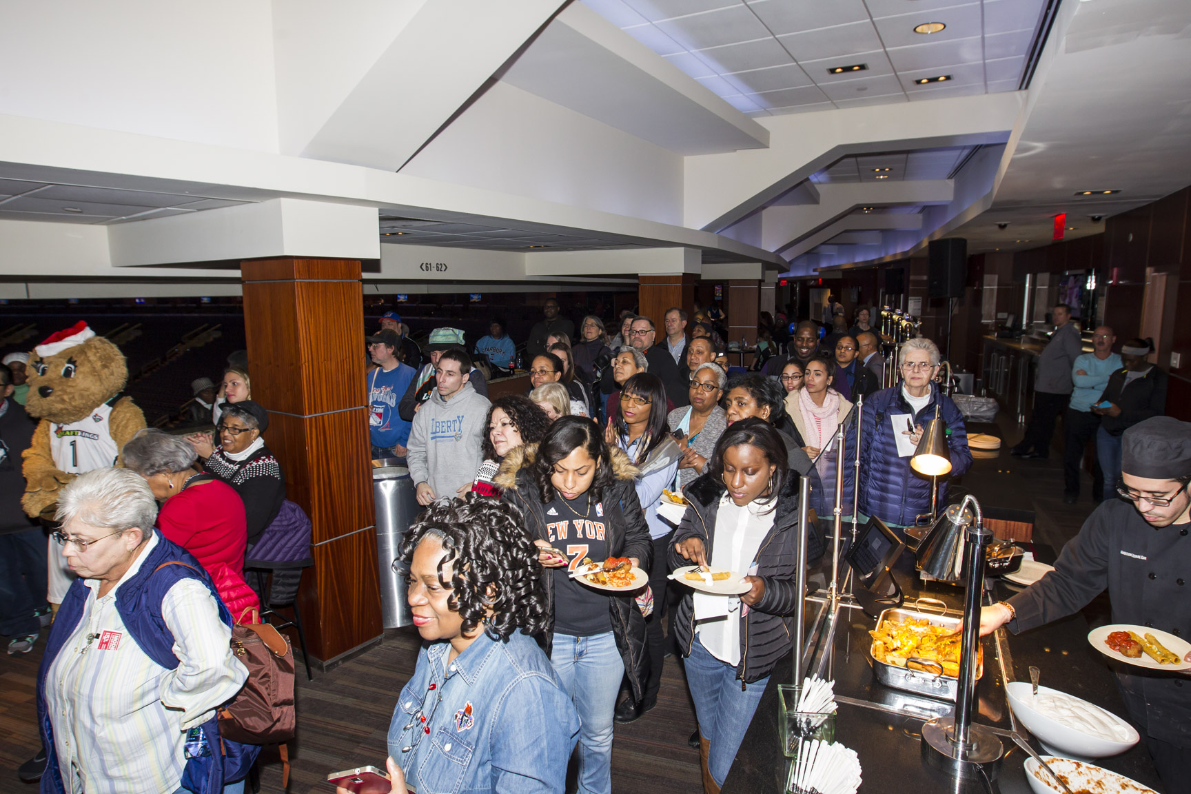 December 28, 2015: The New York Liberty host a holiday party for season subscribers in the Madison Club prior to the Maggie Dixon Classic at Madison Square Garden, with special guests Teresa Weatherspoon and Swin Cash.
